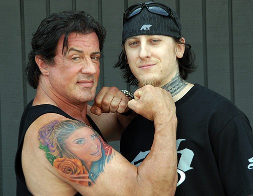 Sly Stallone with a portrait of his wife, Jennifer Flavin, by Mike DeVries